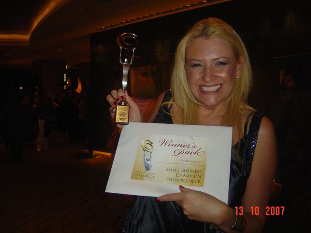 danni-and-her-entrepreneur-of-the-year-trophy.JPG